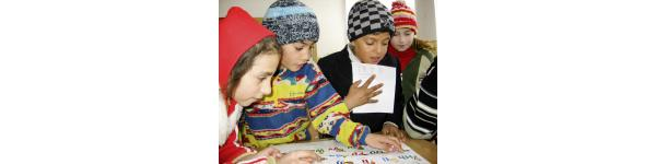 children playing and writing