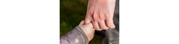 child holding adult finger