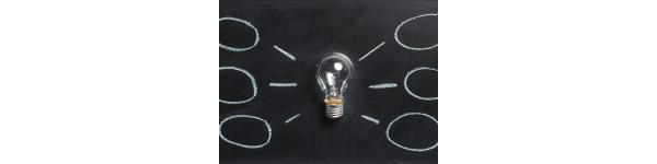 lightbulb with idea bubbles