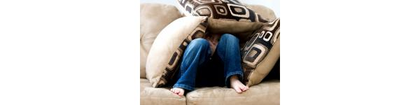 boy on couch protected by cushions