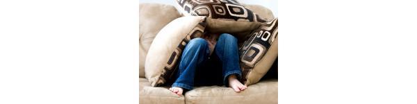 Child under pillows