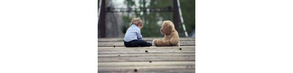 Child with bear toy
