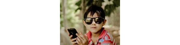 children holding a phone