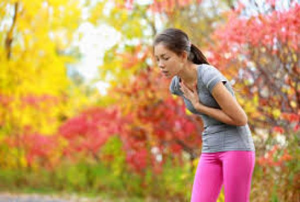 The running girl feels bad in the middle of running. There is a colorful landscape in the background.